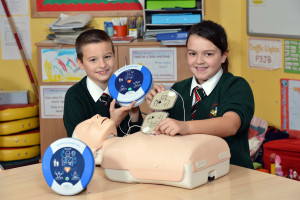 Joshua Watters and Emily Stothers of Dundonald Primary School show HeartSine AED