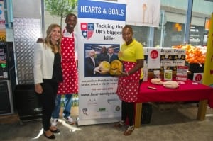 Sara Newbold, from Arrhythmia Alliance with Fabrice Muamba and wife Shauna at Mrs Muamba's tasting session