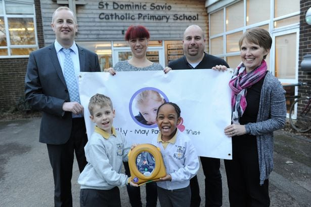 (L-R) James broadbridge, Claire Page, Rory Davies, and Claire Willoughby. Pupils Dominic Taylor and Cynthia Mulovi