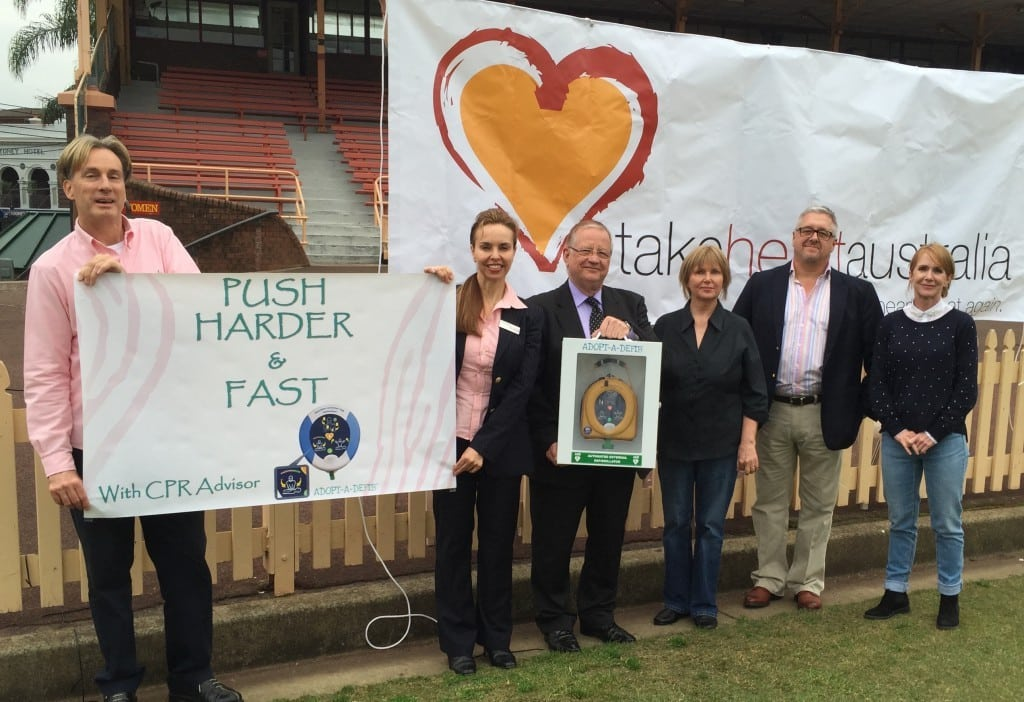 John and Elizabeth Lucas (center) joined by staff from Adopt-A-Defib™ and Take Heart Australia.