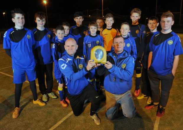 Coaches and players at Kirkliston and South Queensferry Football Club with their new HeartSine defibrillator. Photo courtesy: Ian Rutherford
