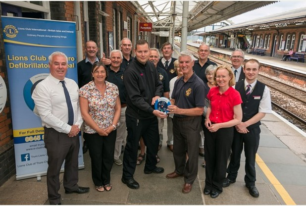 Front row: Paul Williiams and Elizabeth Williams from the Ronnie Richards Memorial Charity, Truro station supervisor Tom Watts receiving the new public access defibrillator from Keith Wellinton, councillor Fiona Ferguson and train dispatcher Cameron Boucher with members of the Truro Lion's Club at Truro Train Railway Station.